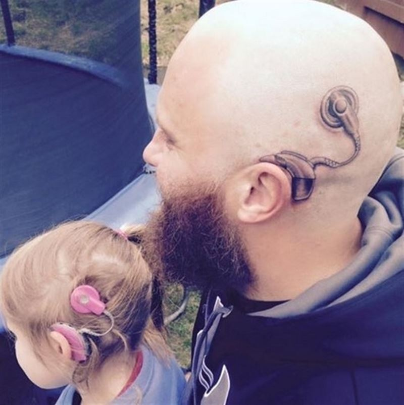 Awesome Dad from New Zealand got a cochlear implant tattoo 'out of love' for his daughter.