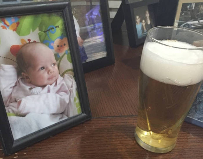 Baby already has his eye on beer.