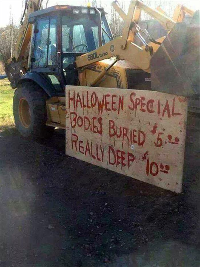Backhoe operator has a Halloween special.