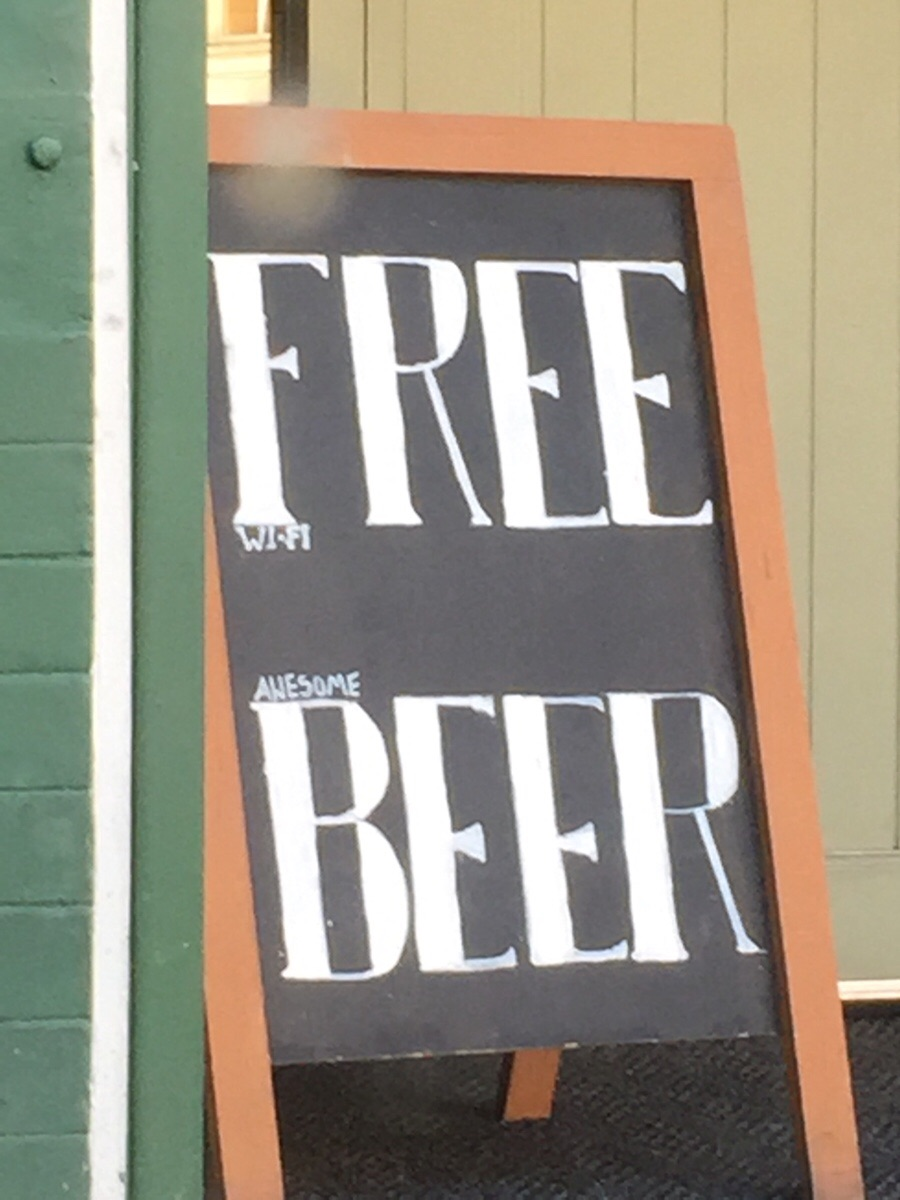 Clever sign to get people in the door offering free beer. Nobody reads the fine print these days.