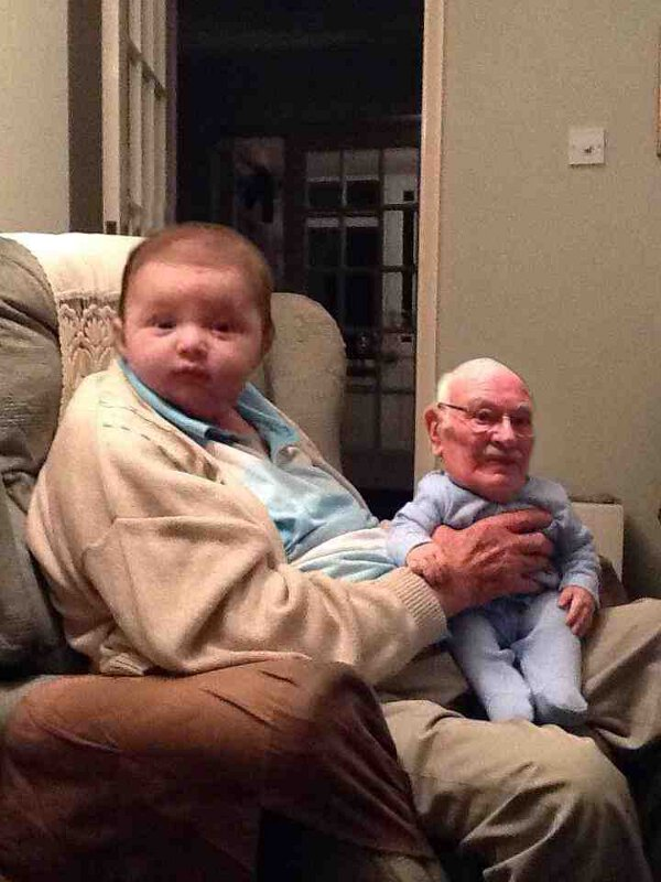 Cute Picture Of A Baby Holding Grandpa On His Lap.