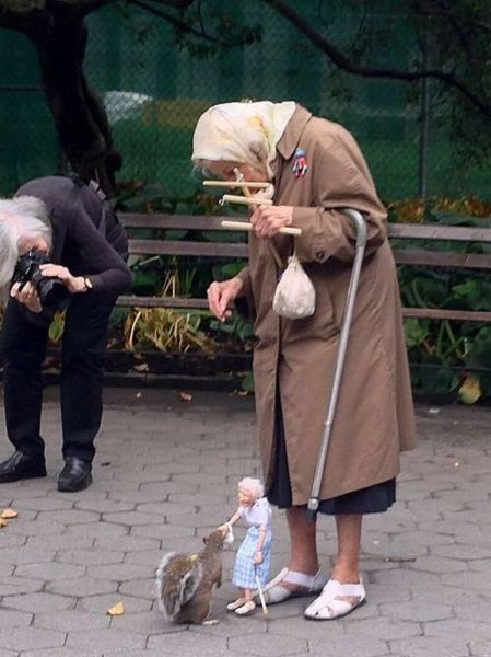 Elderly Woman Has Found A Fun And Unique Way To Feed The Squirrels.