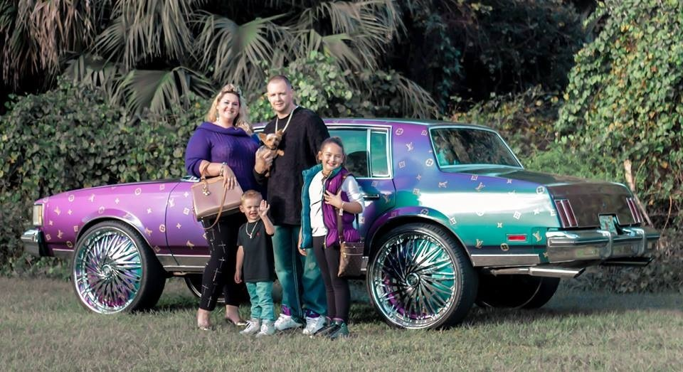 Did this family buy their clothes before or after painting their car?