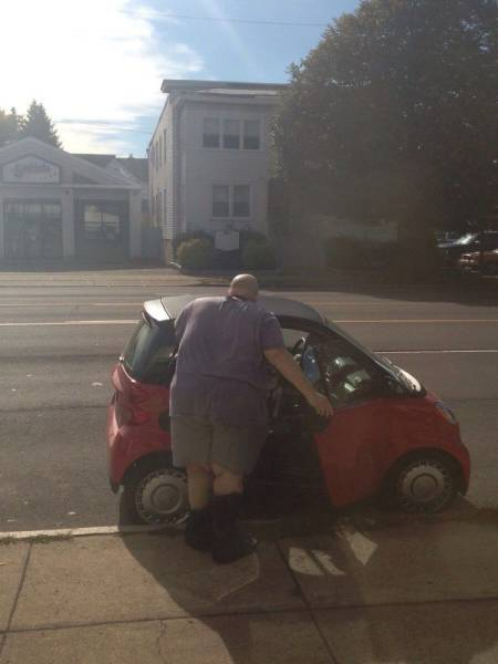 Fat guy and a Smartcar. This could get interesting.