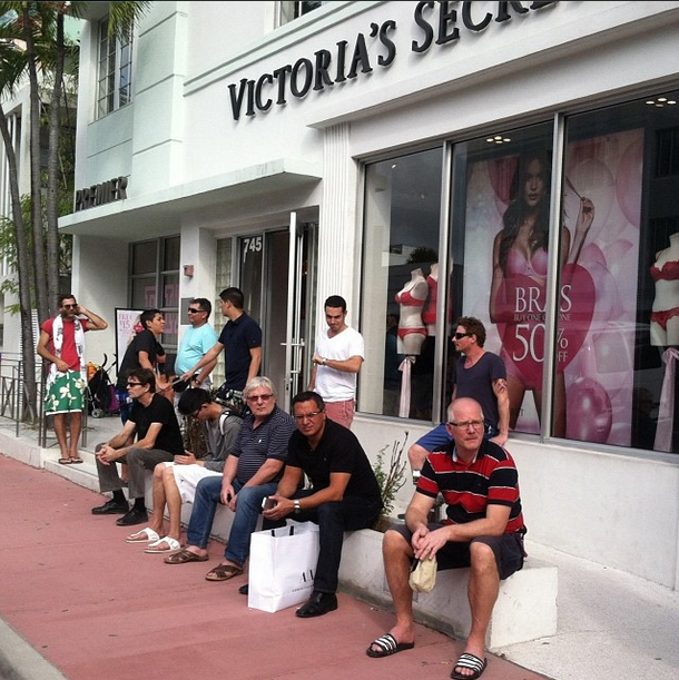 Guys waiting for their wives outside Victoria's Secret.