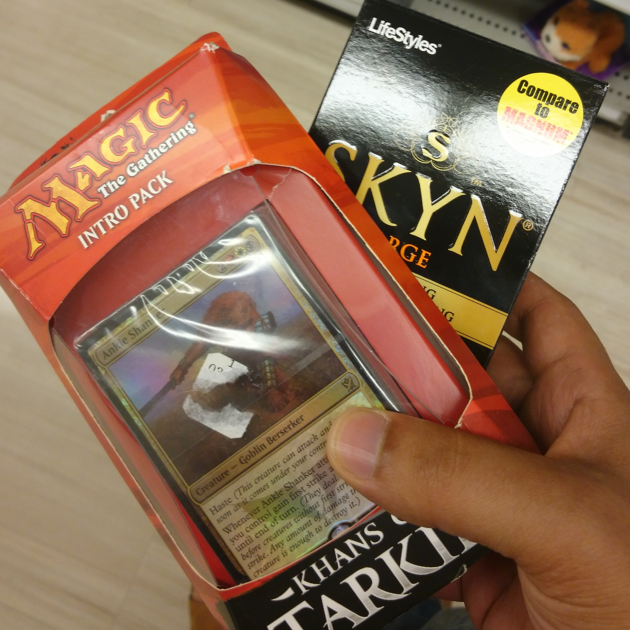 How to totally confuse the cashier. Magic: The Gathering intro pack and condoms.