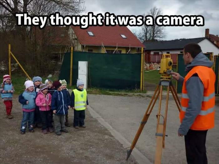 Kids thought this land surveyor was taking a picture.