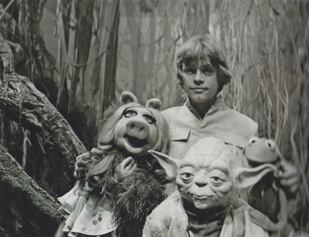 Luke Skywalker, Kermit the Frog, Miss Piggy, and Yoda pose for a picture on the set of