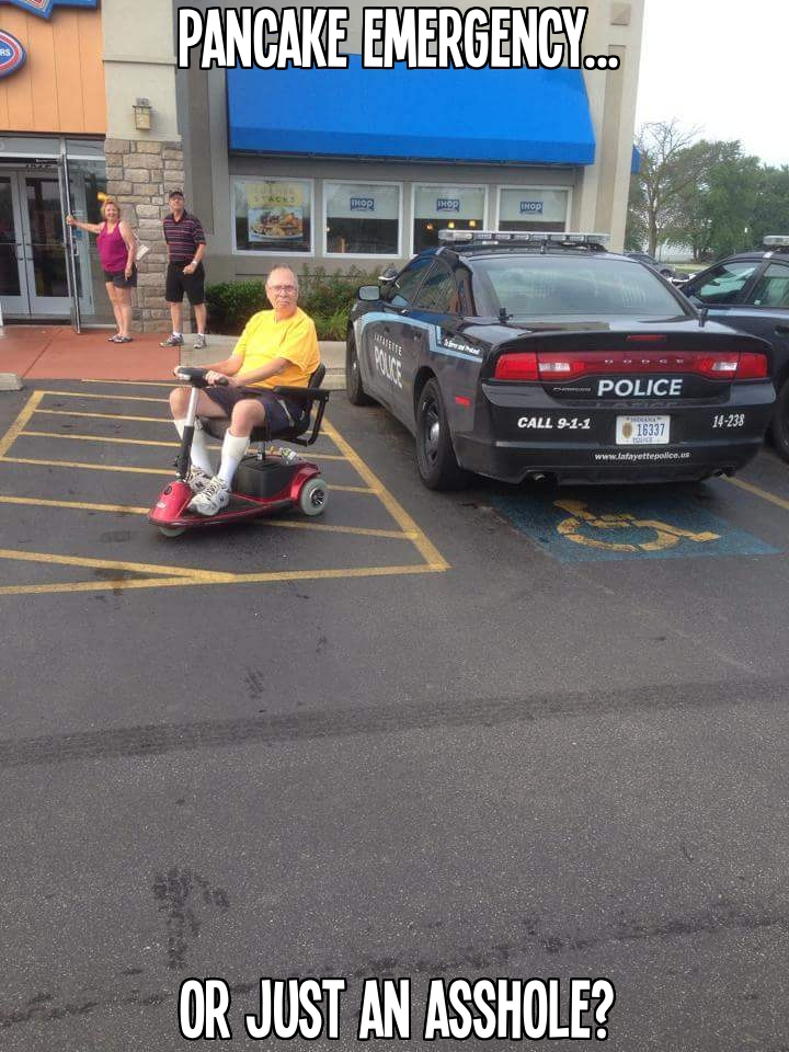 Man in mobility scooter finds a great photo op when a cop car parks in a handicap spot at an IHOP restaurant.