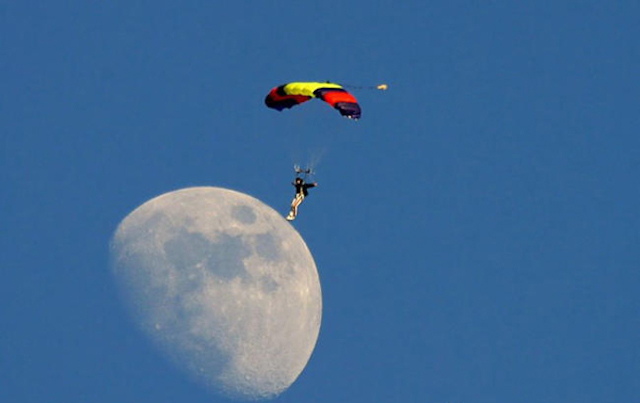 Man Lands On The Moon Using A Parachute.
