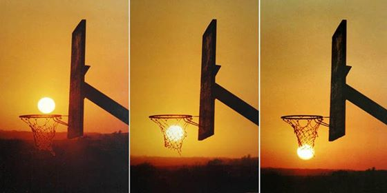 The sun playing a game of hoops drills a 3 pointer from down town.