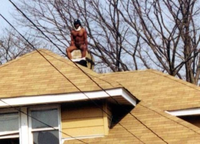 This man appears to be taking a dump down someones chimney. I wonder if it was even Christmas?