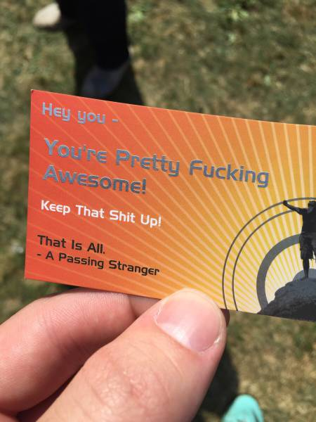 Passing stranger hands out business cards.
