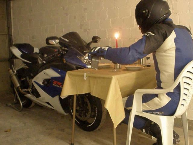 Romantic candlelight dinner for two. Man and his motorcycle can never be parted.