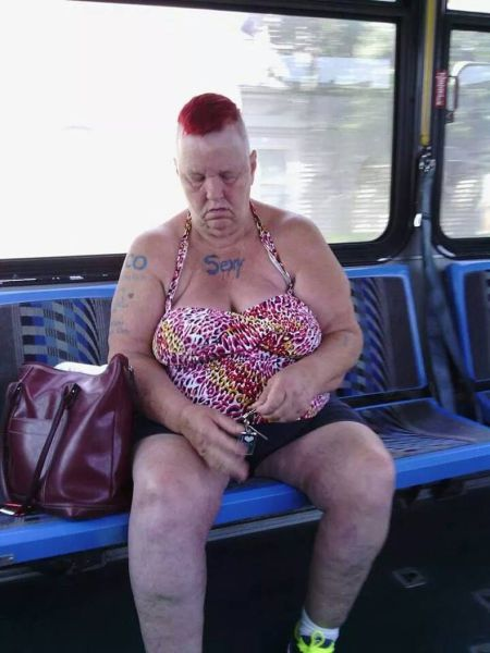 This woman on the bus has so much sex appeal she decided to get it tattooed on her chest.