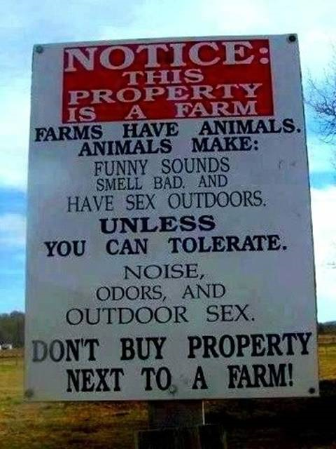 Sign for those city slickers looking to buy property next to a farm.