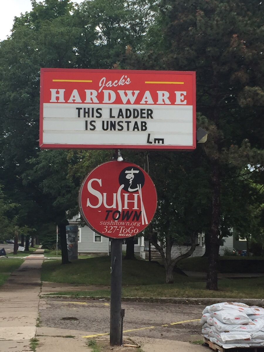 Sign outside local hardware store shows they have a sense of humor....or crappy ladders.