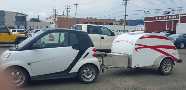 Smartcar pulling a teardrop trailer is a great camping set up for the less is more crowd.