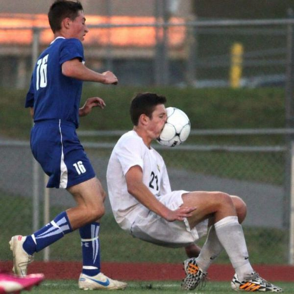 Soccer Player Gets A Face Full Of Ball In This Perfectly Timed Picture.
