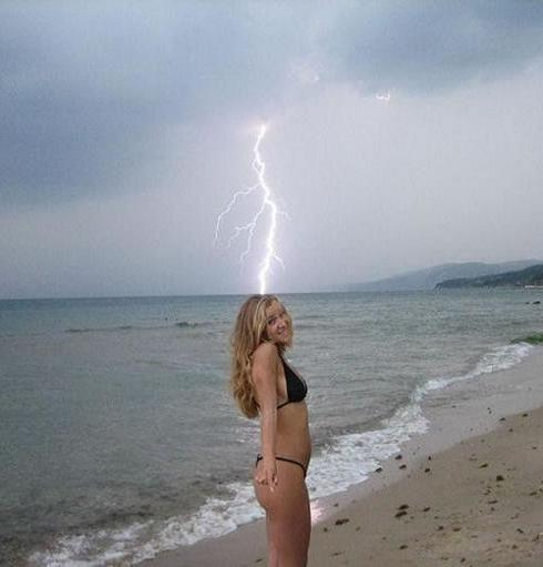 Beach hottie in bikini gets nailed by lightning strike.
