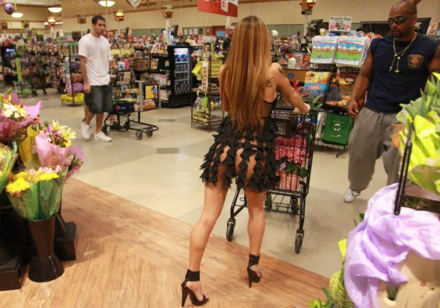 This woman seems to be dressed a bit too classy for Wal-Mart.