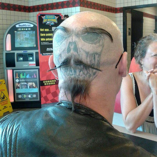 This Guy Adds An Extra Sense Of Style To His Back Of The Head Tattoo.