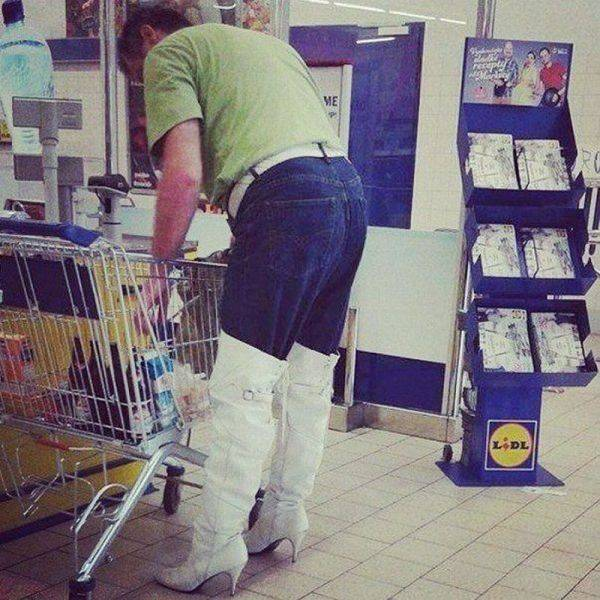 This guy is a real trendsetter with his knee high heeled boots over his jeans.