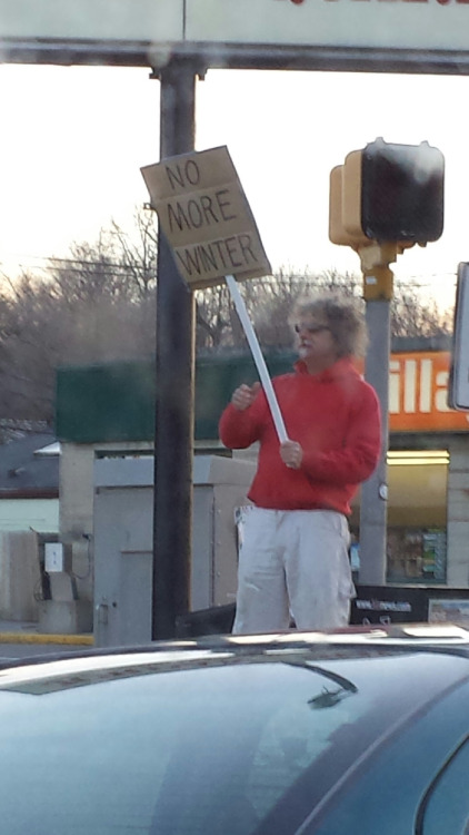 This guy hates winter so much he is protesting it.