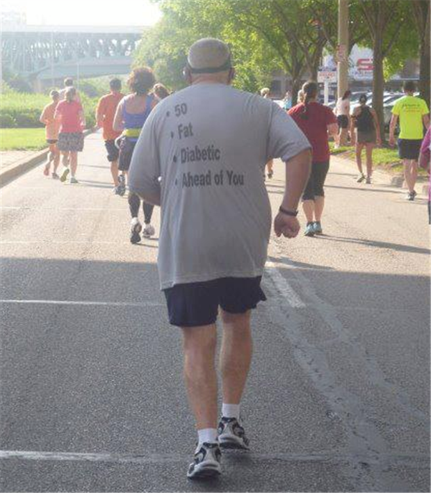 This man running in a marathon has a great motivational shirt for the runners behind him.