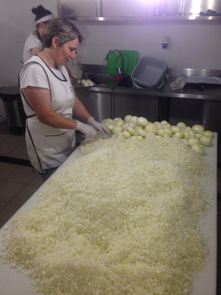 This Picture Of A Woman Cutting A Huge Pile Of Onions By Hand Will Make You Cry Just Looking At It.