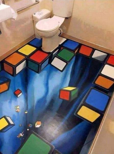 Trippy bathroom floor with falling Rubik's Cube pieces.
