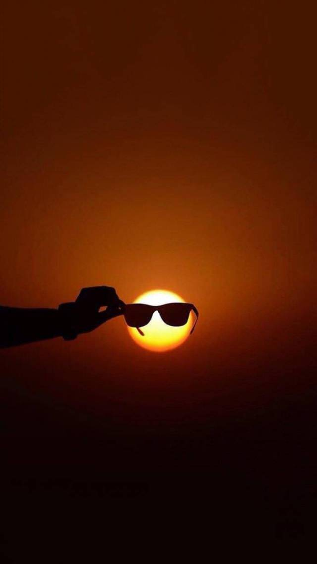 The sun is so bright its gotta wear shades.