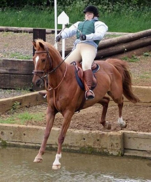 This woman riding on her horse does not look very calm about the upcoming landing.
